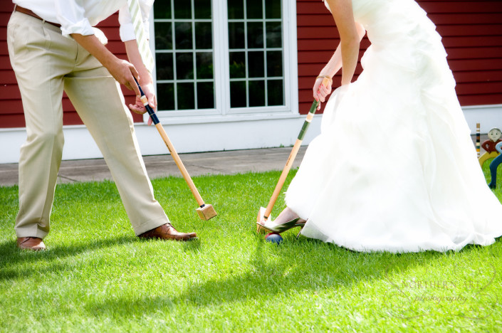 Bride and groom playing croquet on the back lawn at the Inn at Black Star Farms.