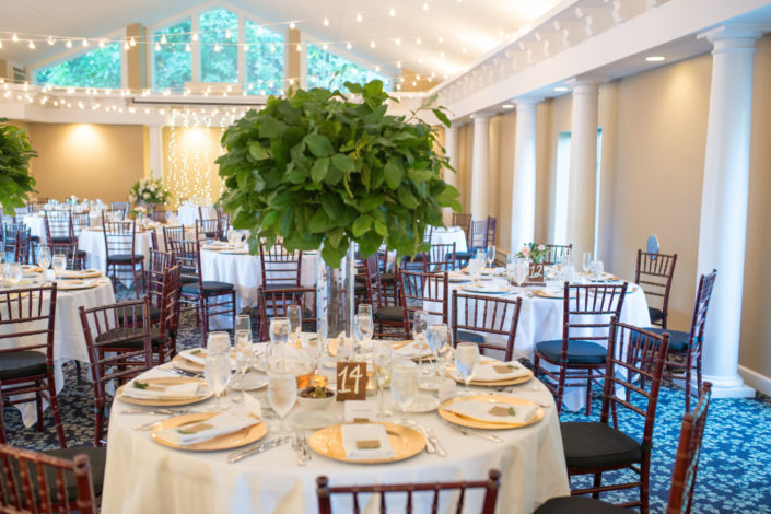 Round tables decorated for a wedding reception in the Aquarius Room at the Inn at Black Star Farms.