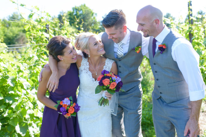 Bride with bridesmaid and two groomsmen in the vineyard at Black Star Farms Suttons Bay.