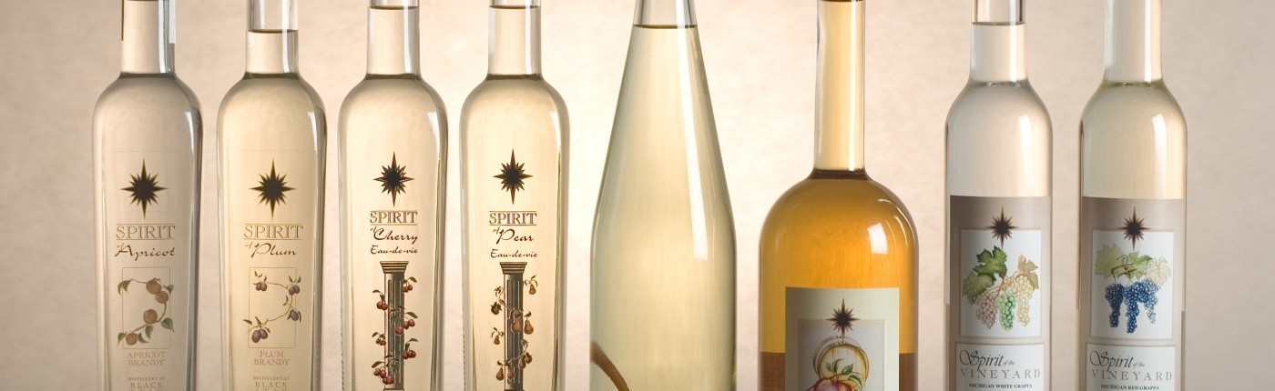 Bottle shots of our distilled spirits including fruit brandies and grappa.