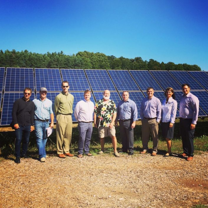 People touring the solar arrays at Black Star Farms Suttons Bay.