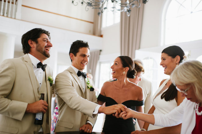 Bride, groom and guests in the front foyer at the Inn at Black Star Farms.