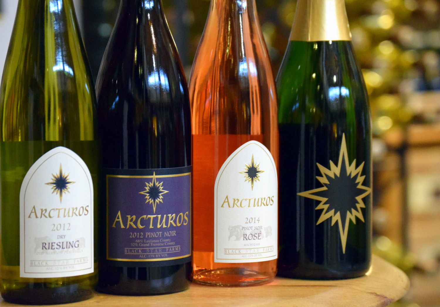 Bottle shot of sparkling, rosé, and red wine from Black Star Farms.