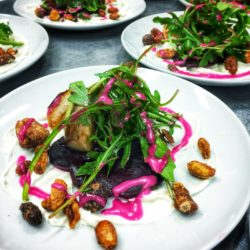 Beet salads with fresh greens and candied nuts.