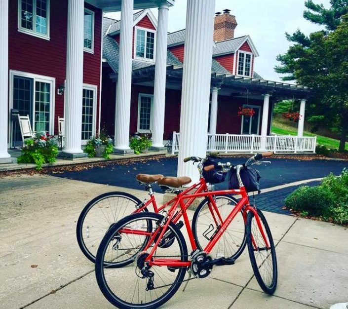Two bicycles in front of the Inn at Black Star Farms