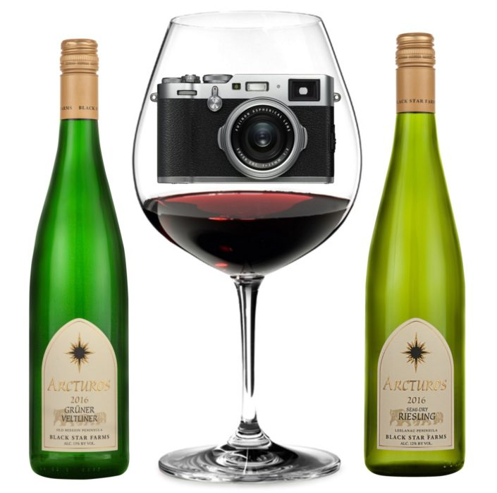 Image of a camera inside a glass of wine with two bottles of Black Star Farms wine.