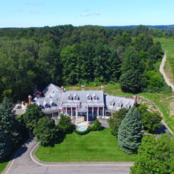 An aerial shot looking down at the Inn at Black Star Farms. at