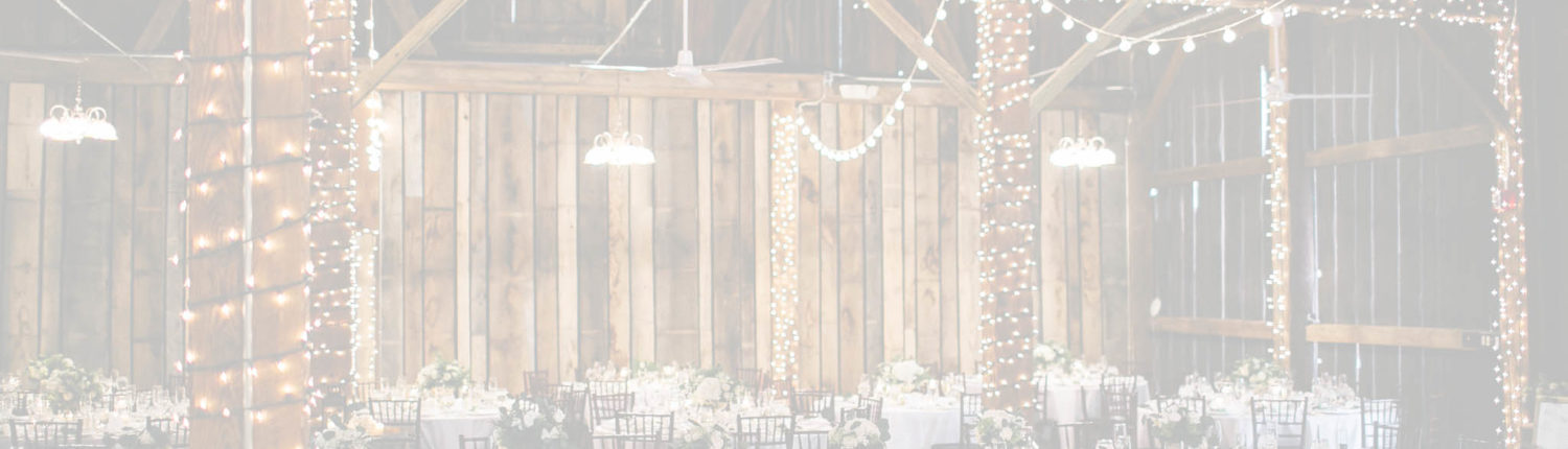 Pegasus Barn with decorated tables and lights.