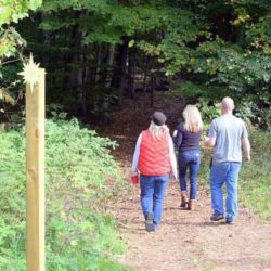 People hiking our trails at Black Star Farms Suttons Bay.