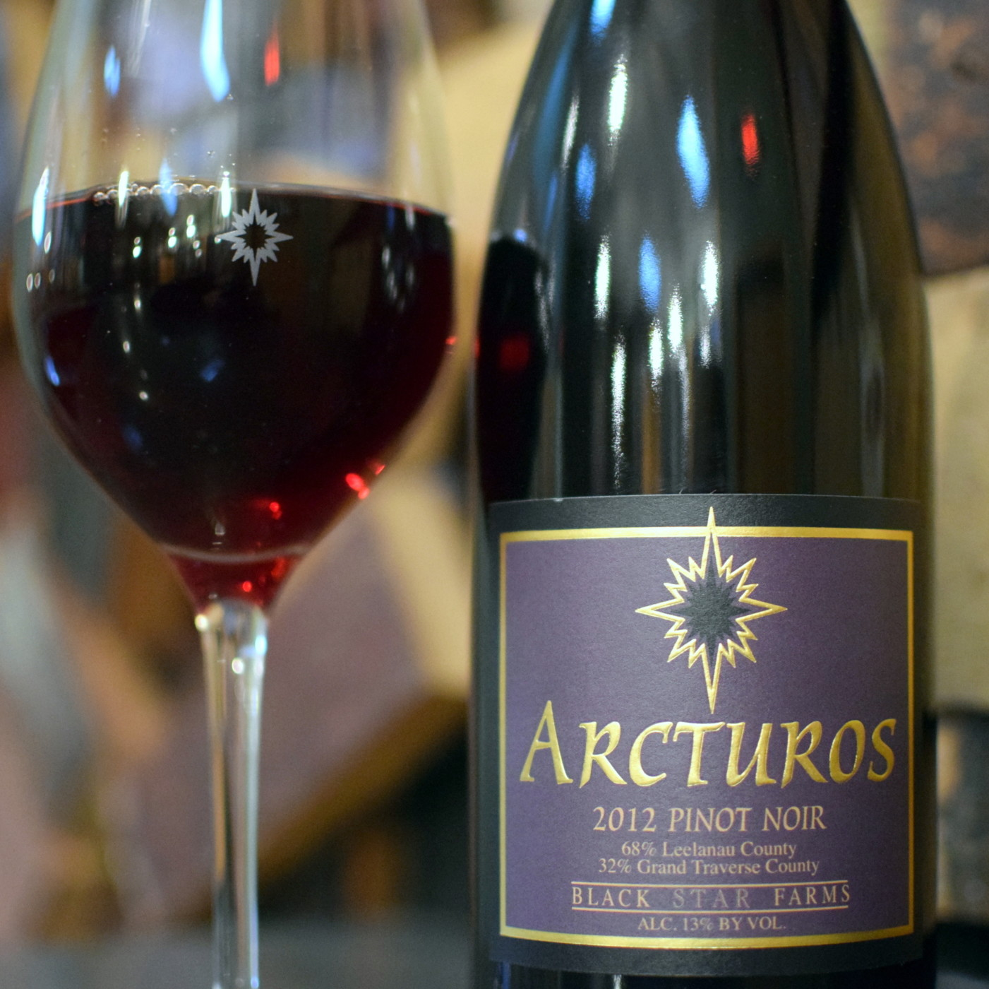 Bottle and glass of Black Star Farms Arcturos Pinot Noir.