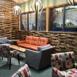 The Barrel Room tasting lounge with couch and chairs at Black Star Farms Suttons Bay.
