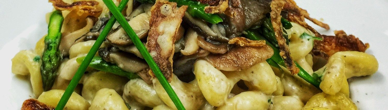 Pasta with wild mushrooms and asparagus.