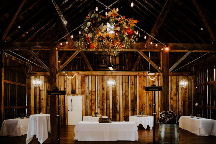 Wedding dinner set up for dancing in the Pegasus Barn at Black Star Farms Suttons Bay.