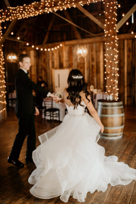 Bride and Groom taking their first dance at the Pegasus Barn at Black Star Farms Suttons Bay.