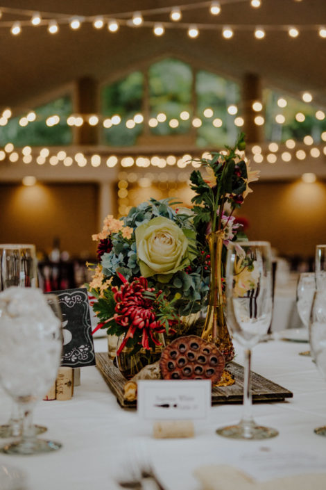Fall flower arrangement on wedding reception table in the Aquarius Room.