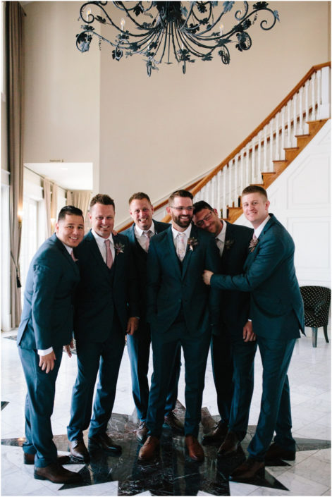 Groom and his groomsmen in the foyer of the Inn at Black Star Farms.