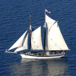 People sailing on the Tall Ship Manitou on Grand Traverse Bay.