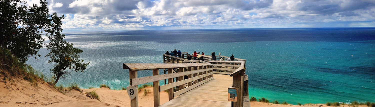 People enjoying views of Lake Michigan at the Sleeping Bear Dunes National Lakeshore.