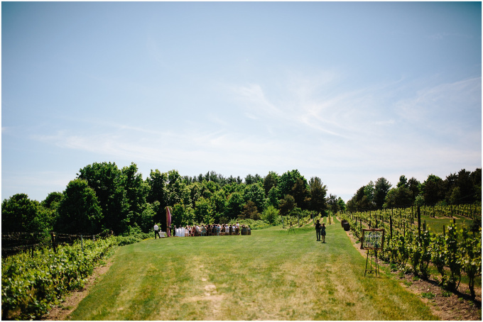 A far away view of the Scenic Hilltop Vineyard site with wedding happening.
