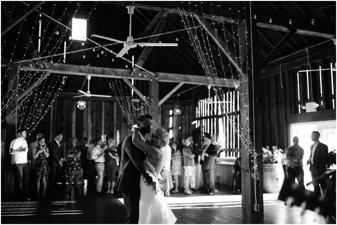 Bride and groom's first dance in the Pegasus Barn at Black Star Farms Suttons Bay.