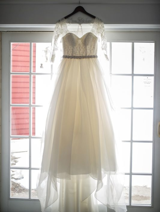 Wedding dress hanging in a window at the Inn at Black Star Farms.