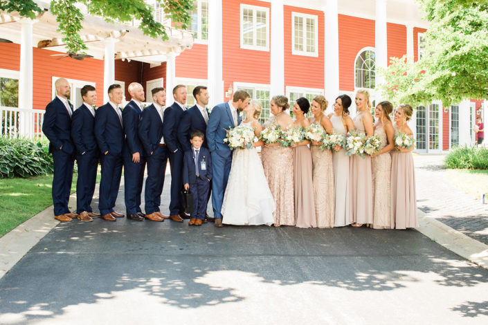 Wedding party standing in front of the Inn at Black Star Farms.