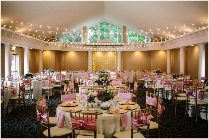 Round tables decorated for a wedding reception in the Aquarius Room.