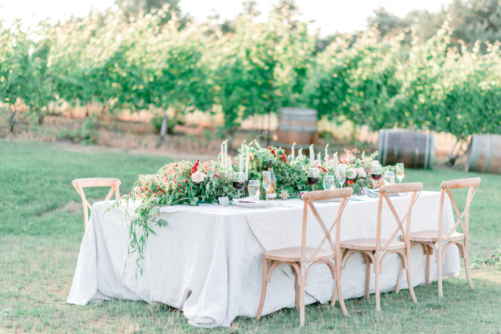 Lavishly set wedding party table in the vineyard at Black Star Farms Suttons Bay.