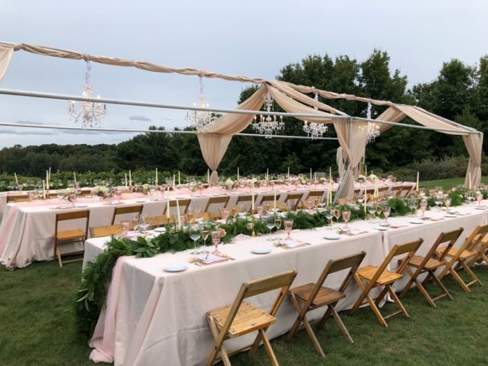 Long tables decorated for a wedding reception dinner at our scenic hilltop vineyard site.