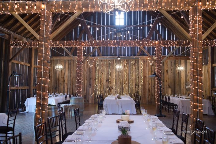 Wedding reception with decorated long tables in the Pegasus Barn.