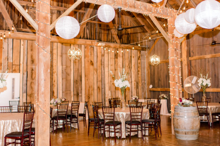 Decorated round tables for a wedding reception with Chinese lanterns in the Pegasus Barn.