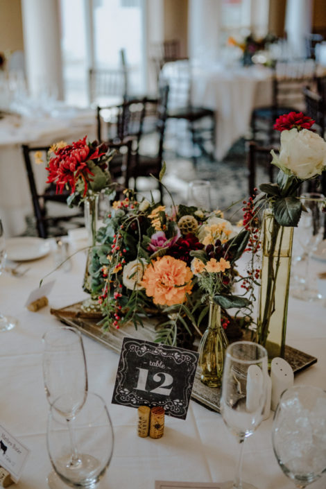 Close up of table with flowers at a wedding reception at Black Star Farms.