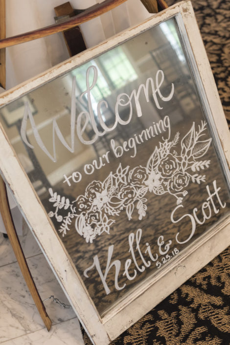 "Sign painted on an old window that says, ""welcome to our beginning."""