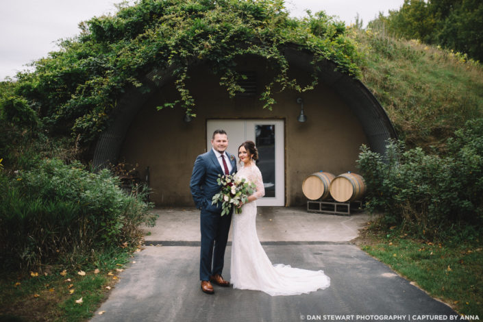 Wedding couple in front of the wine cave.