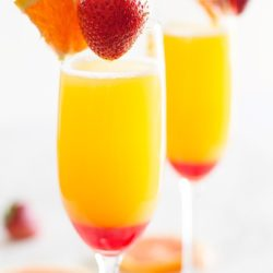 Example of mimosas with fresh strawberries that you can make at the Mimosa Bar at our Mother's Day Brunch.