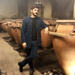 Winemaker discussing the use of amphorae for aging wine at Foradori winery in Trentino - Alto Adige, Italy.