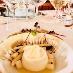 A plate with ricotta souffle and white asparagus with white wine pairings at the restaurant at Ferruccio Sgubin winery, Italy.