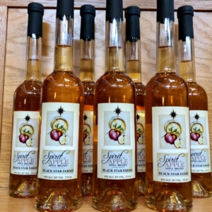 Many bottles of Black Star Farms Apple Brandy displayed in our Suttons Bay tasting room.