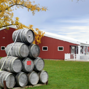 Stacked wine barrels at the entrance of Black Star Farms Old Mission.