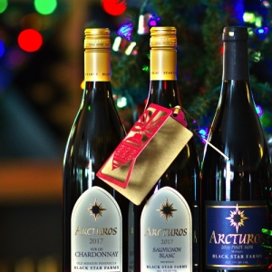 Three bottles of Black Star Farms wine with holiday flare.