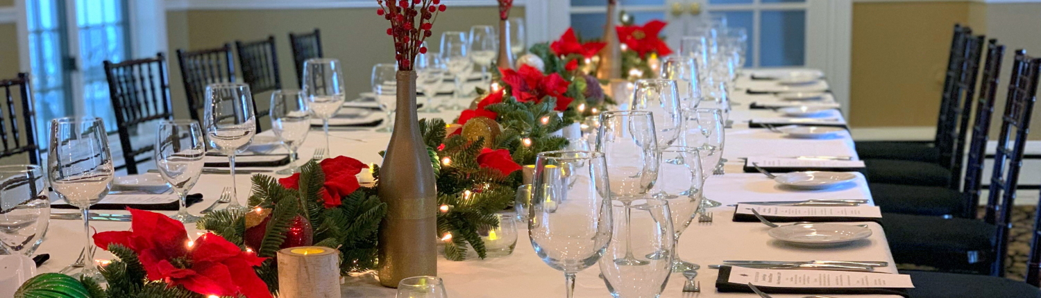 Table set with holiday decor for holiday parties at the Inn at Black Star Farms.