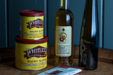 Black Star Farms Apple Brandy, Sirius Maple Dessert Wine, Whitley's Peanuts, and a chocolate bar.