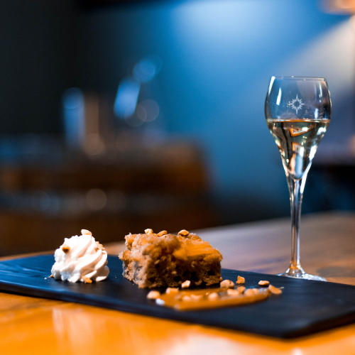 Apple spice cake with a glass of our Sirius Maple Dessert Wine.