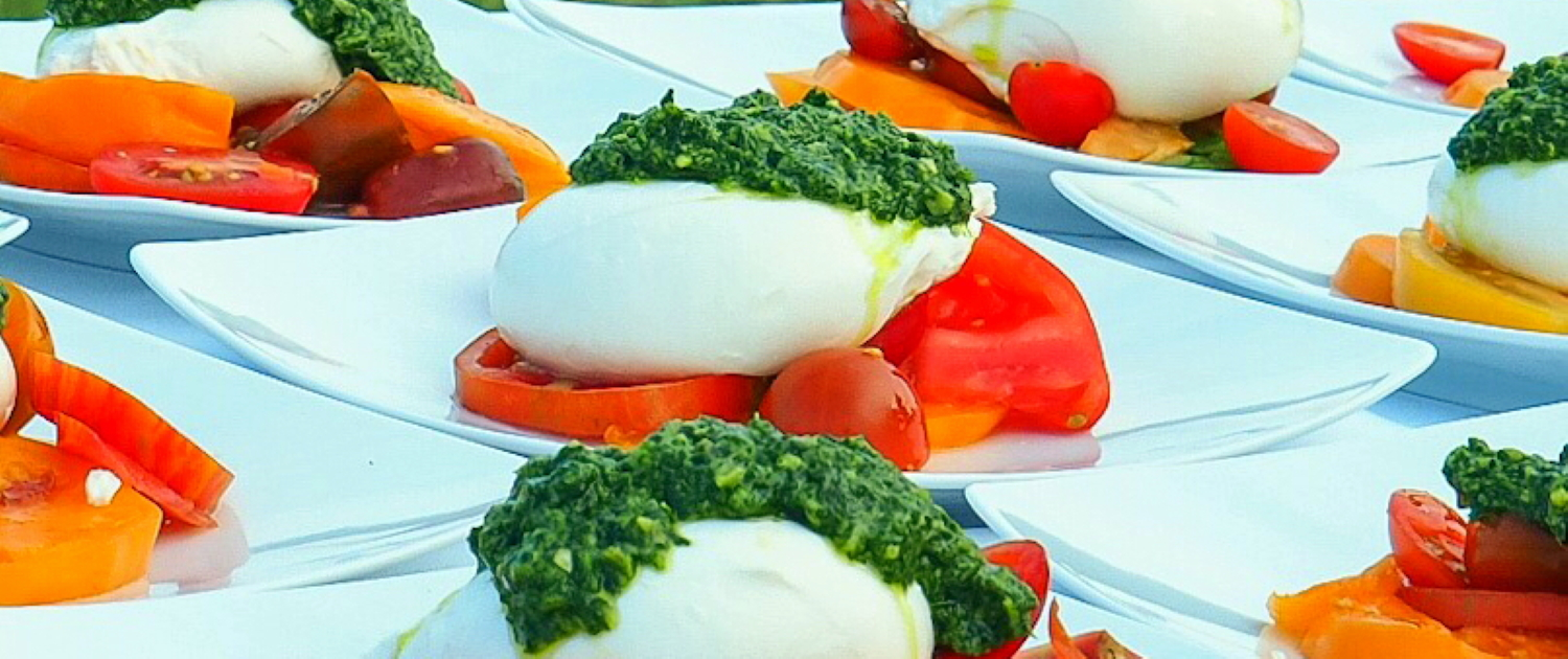 Tomato Burrata Salads topped with pesto from our Arcturos Dining Series
