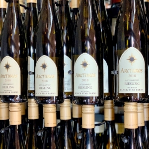 Bottles of 2018 Arcturos Late Harvest Riesling in the tasting room at Black Star Farms Suttons Bay.