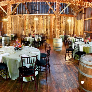 Pegasus Barn set with round tables for a wedding reception.