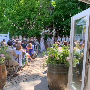 Small wedding ceremony on the stone patio off the Inn at Black Star Farms.