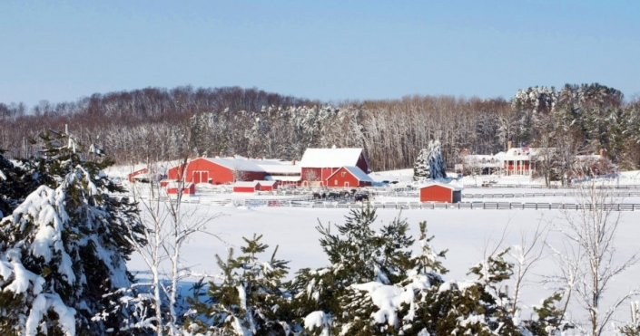 A faraway image of a snow covered Black Star Farms Suttons Bay.