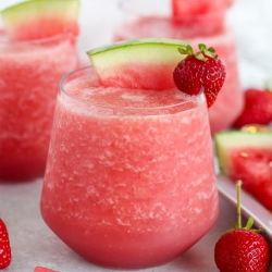 Example of Frose Fruit Slushies with strawberry and watermelon garnish.
