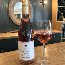 Bottle and glass of our Wine Club Selection Rose of Pinto Gris.